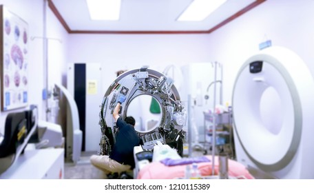 Maintenance engineer repairing and checking CT scanner machine every 3 month in the hospital. Services concept.