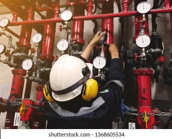 maintenance man repairing the pipe of fire hose in the factory