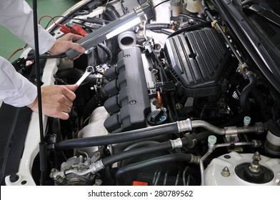 Maintenance of motor vehicles. It is made in Japan car of being repaired.