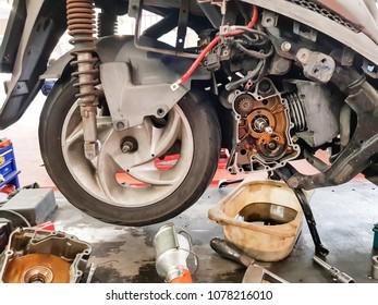 Maintenance motorbike repair automotive worker, oil engine change.