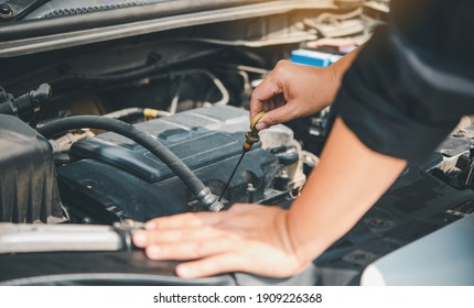 maintenance technician is doing a preliminary inspection of the engine to be ready to use. Concept of car maintenance