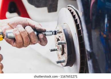 Maintenance technicians are replacing brake the vehicle.For safe driving , soft focus , blurred.