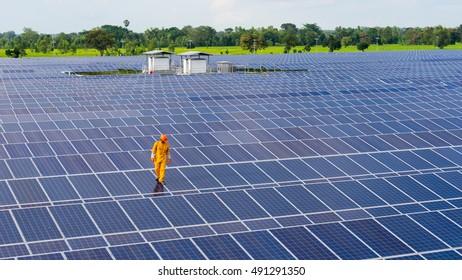 Maintenance workers, men working on solar cells.