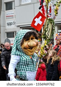 Mainz, Germany - 2014: Narren (fool) entertains the crowd at Mainz Fasching Parade. Fasching, Fassenacht, or Carnival is celebrated in downtown Mainz with a huge parade on Rosenmontag (Roses Monday).
