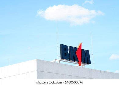 MAINZ, GERMANY - AUGUST 04: The logo of the construction insurance BKM Mainz on the roof edge of a business building on August 04, 2019 in Mainz.