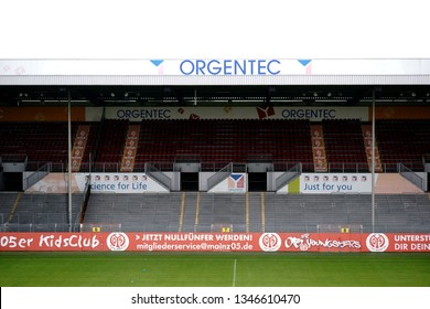 MAINZ, GERMANY - AUGUST 26: A grandstand in Bruchweg stadiumof the football club 1. FSV Mainz 05 with rows of seats, advertising boards and standing room on August 26, 2018 in Mainz.