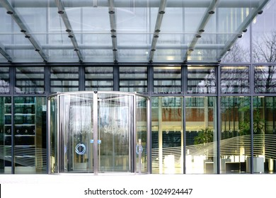 MAINZ, GERMANY - FEBRUARY 10: The glass entrance of Schott AG headquarters in Mainz with a revolving door and a glass roof on February 10, 2018 in Mainz.