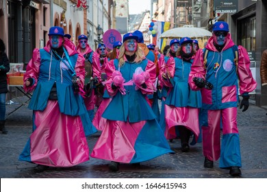Mainz / Germany - February 15. 2020 European Guggen Music festival: guggen music band with blue and pink costumes at the carnival parade