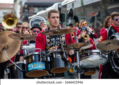 Mainz / Germany - February 15. 2020 European Guggen Music festival: concentrated male drummer of a guggen music band at the carnival parade