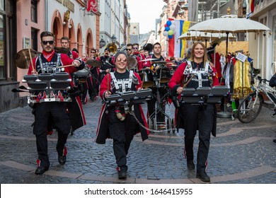 Mainz / Germany - February 15. 2020 European Guggen Music festival: guggen music band with black and red costumes at the carnival parade