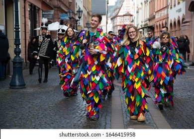 Mainz / Germany - February 15. 2020 European Guggen Music festival: guggen music band with traditional patchwork costumes at the carnival parade