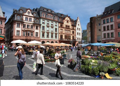 MAINZ, GERMANY - JULY 19, 2011: Tourists visit farmer's market in Mainz, Germany. According to its Tourism Office, the town has up to 800,000 overnight visitor stays annually.