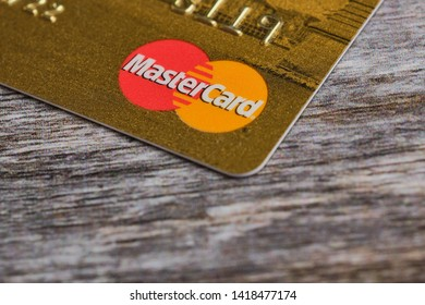 Mainz, Germany - June 07, 2019: Credit card with MasterCard logo on wooden background. MasterCard is an American multinational financial services corporation headquartered in New York, United States