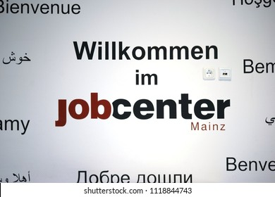 MAINZ, GERMANY - JUNE 18: A wall of the job center Mainz on May 18, 2018 in Mainz, described with a welcome message in different languages.