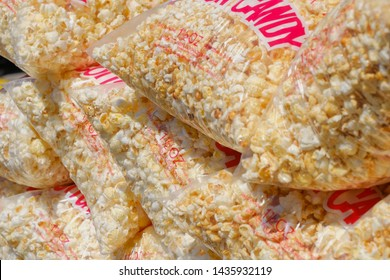 Mainz, Germany - June 24, 2019: Plastic bags with popcorn on a German funfair in Mainz, Germany.