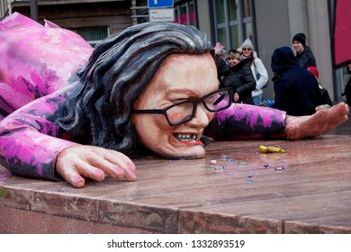 Mainz, Germany - March 04, 2019: Detail of a carnival venture: the leader of the SPD party, Andrea Nahles, is lying on the floor with broken glasses and gaps in her teeth