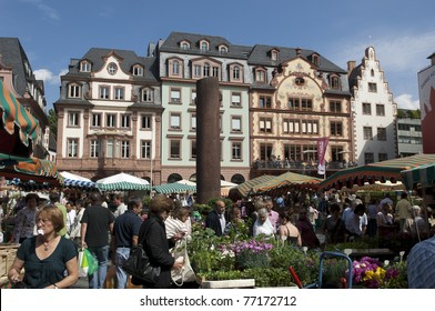 MAINZ, GERMANY - MAY 14: Local farmers selling fresh products at the Saturday farmer Market market on May 14, 2011 in Mainz, Germany. This market is now over 1000 years old and held every Saturday.