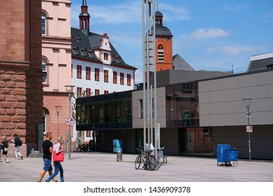 MAINZ, GERMANY - MAY 27, 2019: Shops and passers-by in good weather on the Gutenbergplatz on May 27, 2019 in Mainz.