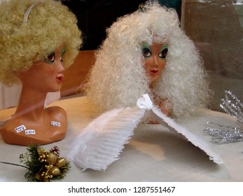 Mainz, Germany - November 18, 2005: angel's toupee on a display dummy head and wings for sale in a shop window