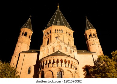 Mainz, Germany, October 12th. 2018 - East facade of the Cathedral St. Martin Dom in Mainz illuminated at night. After burning down in 1009, the cathedral was reconstructed and reopened in 1036.