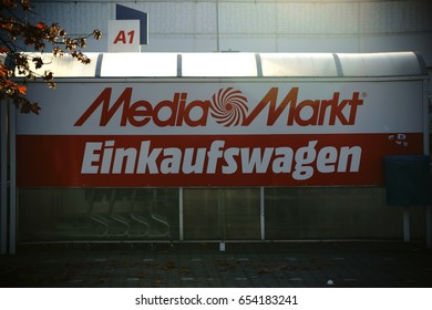 Mainz, Germany - October 29, 2016: The company logo of the HIFI market Media Market at a shelter for shopping carts on October 29, 2016 in Mainz / Shopping carts Media Market