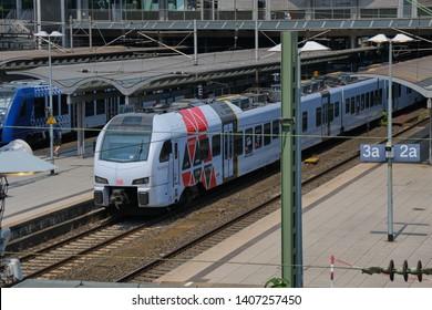 Mainz, Germany on May 24, 2019: Two trains waiting in Mainz main railway station - Mainz Hauptbahnhof - railway station for city of Mainz in German state of Rhineland-Palatinate.