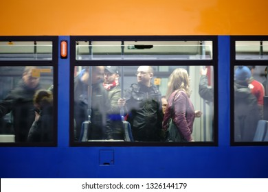 MAINZ, GERMANY - SEPTEMBER 27: Fans of football club 1. FSV Mainz 05 stand and sit in a crowded tram on September 27, 2018 in Mainz.