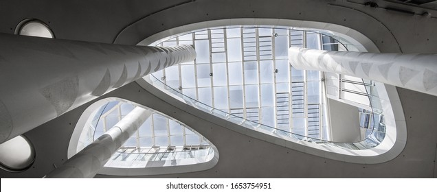 Mainz, Rhineland-Palatinate  / Germany  - Juni 28. 2019 : inside the business building called marked No. 11-13. With a white atrium and with skylight taken from below with columns that extend upwards