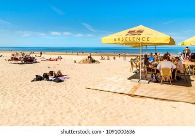 Maiori, Jurmala, Latvia - May 12, 2018: People enjoy the sunny spring day on the Baltic sea gulf beach in Jurmala resort, Latvia.