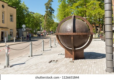 Maiori, Jurmala, Latvia - May 12, 2018: The biggest rotating globe in Latvia situated on one of the streets leading to the beach in Jurmala, Latvia