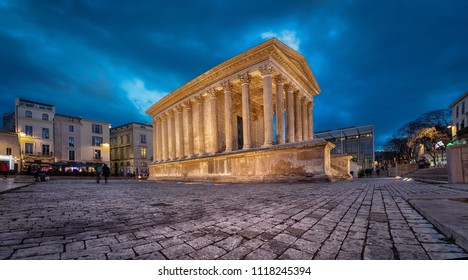Maison Carree - restored roman temple dedicated to 'princes of youth', with richly decorated columns & friezes in Nimes, France