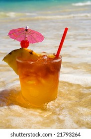 A Maitai cocktail in the water at the beach