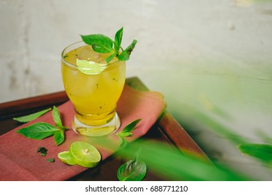 """"""" Mai-thai """"  Yellow Cocktail with Lime , Mint Have Leaf Foreground"""