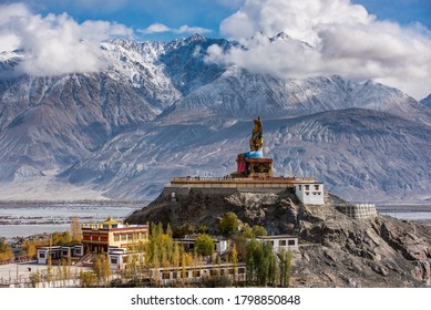 The Maitreya Buddha statue with Himalaya mountains in the background from Diskit Monastery or Diskit Gompa, Nubra valley, Leh Ladakh