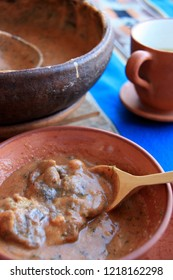 "Maize Soup with Alpaca Meat (Lomo de Alpaca), a well known delicacy in the Andes Mountain Region in Peru. Clay cup of ""Mate de Coca"" on the right side of the picture."