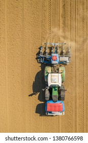 maize sowing tractor on dry field in southern germany