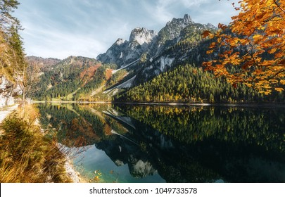 Majestic alpine highlands in sunny day. Unsurpassed sunrise in the mountains. Awesome azure lake Under Sunlight. wonderful picturesque Scene. Amazing Highmountain Lake Vorderer, Gosausee. Austria alps