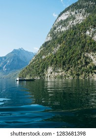 Majestic Alpine landscape with lake Königssee against mountains beautiful sunny day, Bavaria, Germany