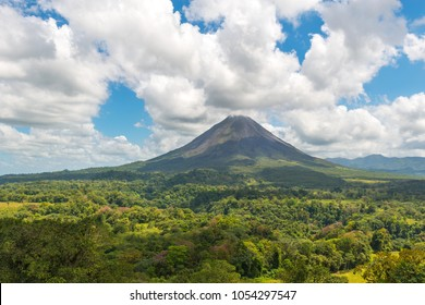 The majestic Arenal volcano surrounded by tropical rainforest on a warm summer day near La Fortuna, Costa Rica, Central America.