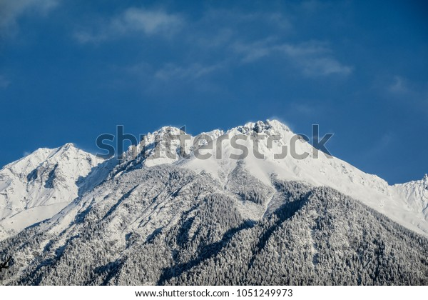 The majestic Austrian Alps covered with fresh snow in March. Heavy winter this one.
