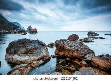 Majestic Black sea and huge stone blocks in the bay. Location place Crimea peninsula, Ukraine, Europe. Wonderful wallpaper. Scenic image of beautiful nature landscape. Discover the beauty of earth.