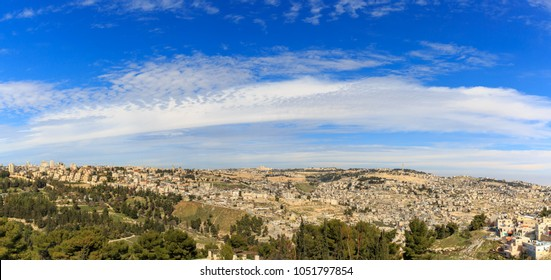 Majestic blue heaven with clouds over panorama of Jerusalem