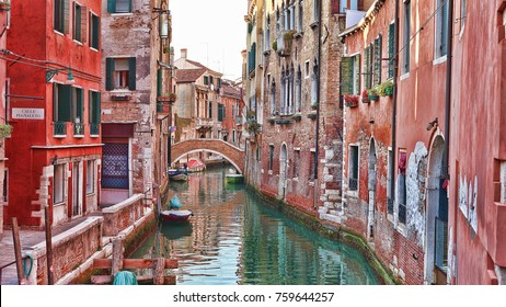 Majestic canals in Venice, and water traffic,Venice, Italy. Gondola in a canal in Venezia Italy. Venice is a city in northeastern Italy and the capital of the Veneto region.