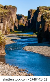 The Majestic Fjaðrárgljúfur Canyon offers dramatic views and a pristine environment of a river that has slowly carved his way in the lavic ground. Southern Iceland - Shutterstock ID 1948441432