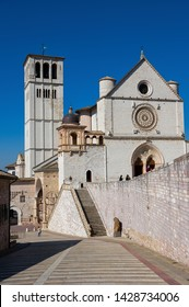 Majestic christian basilica cathedral of Saint Francis of Assisi in Italy on cloudless summer day