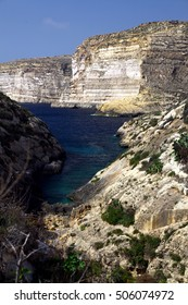 Majestic cliffs drop down to the sea at Xlendi, a small village on Gozo