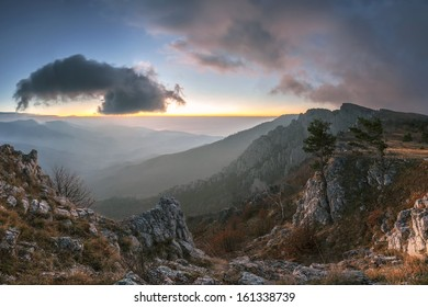 The majestic cloud over the valley, the mountain landscape at sunrise