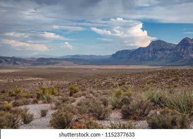 Majestic clouds over the mountains and endless desert.
