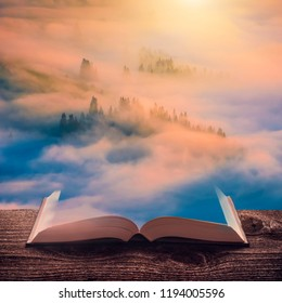 Majestic colorful sunrise in a misty valley on the pages of an open magical book. Majestic landscape. Nature and education concept.