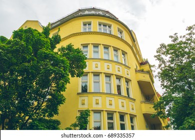 majestic corner house with yellow facade